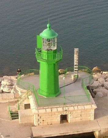 Split Breakwater Light, Split, Southern Croatia. May 2009 Octagonal cast iron tower with lantern and gallery, rising from a 1-story stone equipment building. Lighthouse painted green. photo by Larry Myhre    ..z