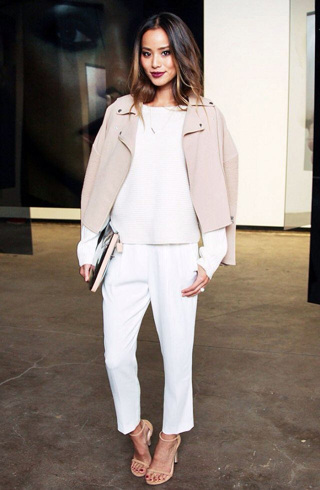 Jamie Chung wearing: ARITZIA Montesson Jacket ($225) in Quill, Avery Sweater ($145) in Espace, and Babaton for ARITZIA Cohen Pants ($145) in Espace.