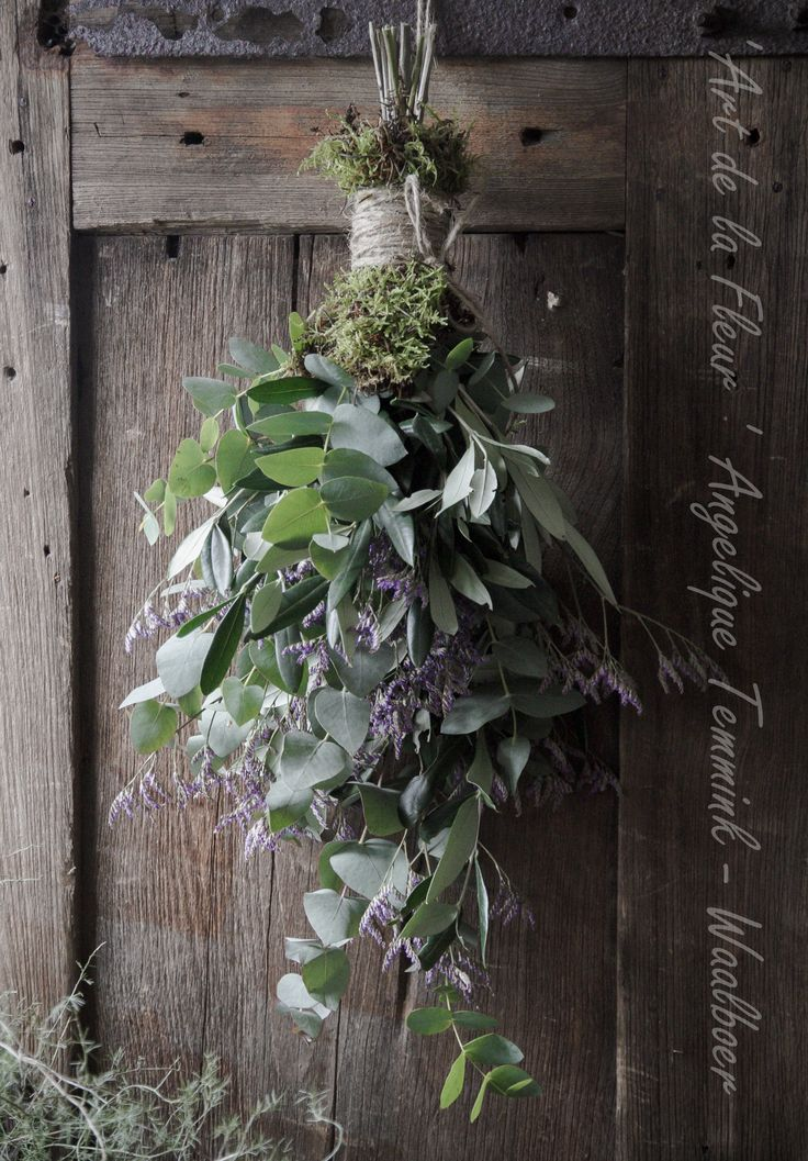 Beautiful fresh greenery. Love the moss wrapped around the top with twine