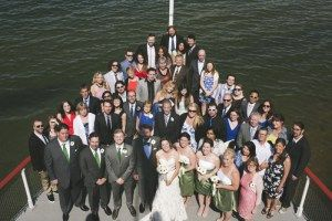 Group Family Photo, looking down onto the bow. - Wedding Photography by Lorena Astrid
