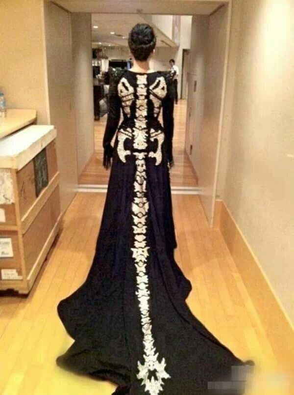 Skeletal gown with dragon tail train.