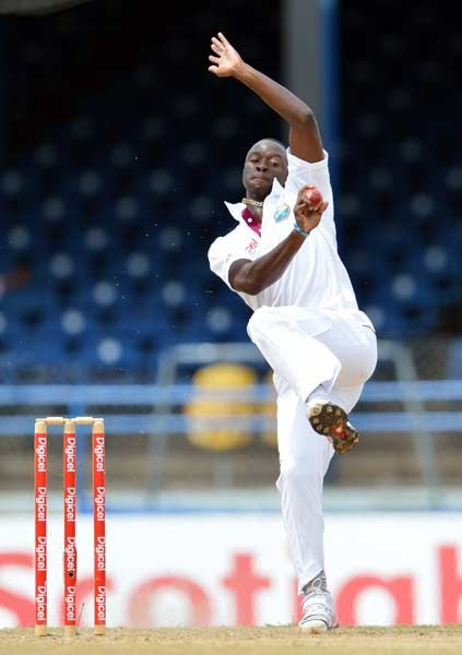 West Indies bowler Kemar Roach delivers during the fourth day of the second-of-three Test matches between Australia and West Indies April 18, 2012 at Queen's Park Oval in Port of Spain, Trinidad.