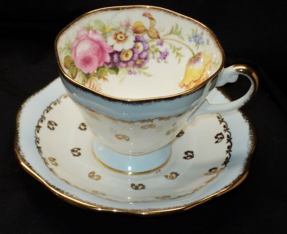 EB FOLEY ENGLAND PINK ROSE YELLOW TULIP BOUQUET FOOTED BLUE TEA CUP AND SAUCER