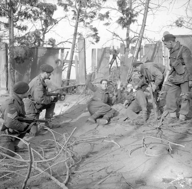 staged photograph, Germans surrender to British commandos from 1st Special Service Brigade near Wesel, North Rhine-Westphalia, Germany.