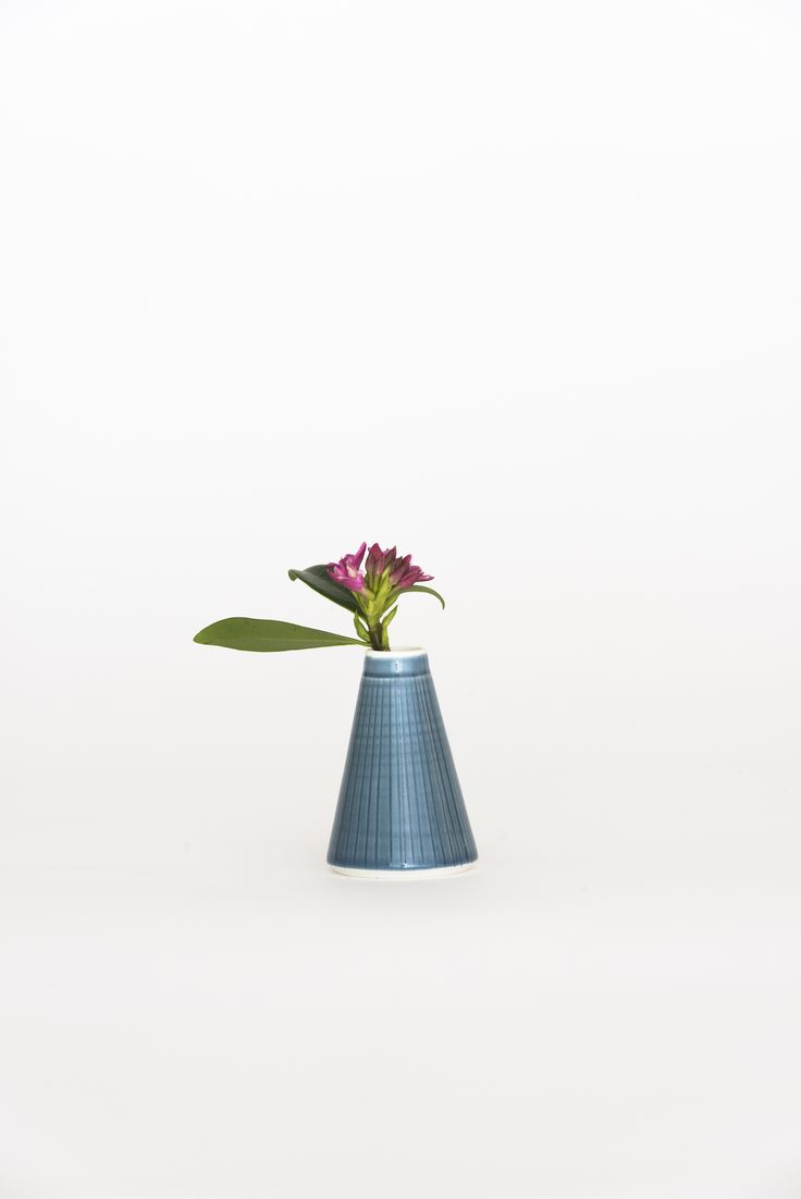 https://councilofobjects.com.au/shop/bud-vase-navy Susan Frost Navy Bud Vase.  Styling: Elise Short for Council of Objects. Photography: Sven Kovac. Location: The Props Dept.