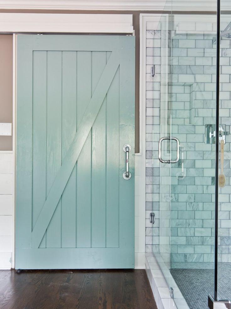 barn door in bathroom....love it with the marble tile and glass shower door