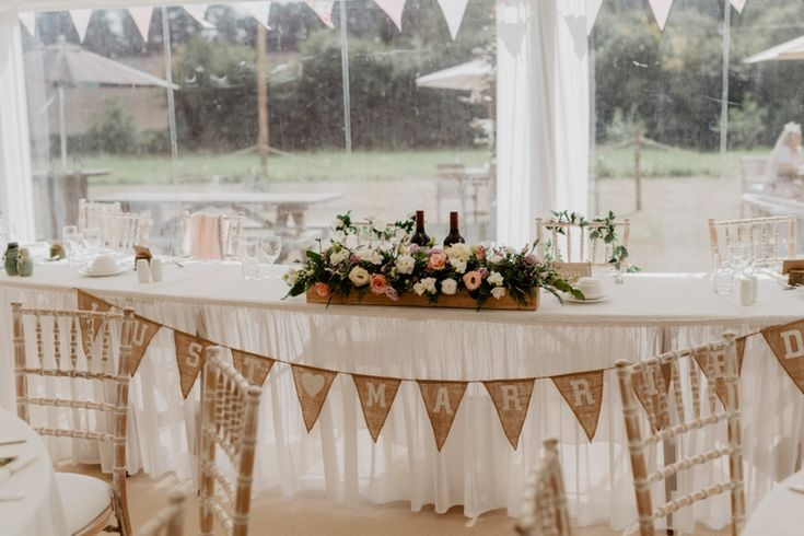 Flowers in rustic wooden boxes give table centres a country vibe. Photo by Benjamin Stuart Photography #weddingphotography #weddingdecor #headtable #weddingflowers #countrywedding #rustic