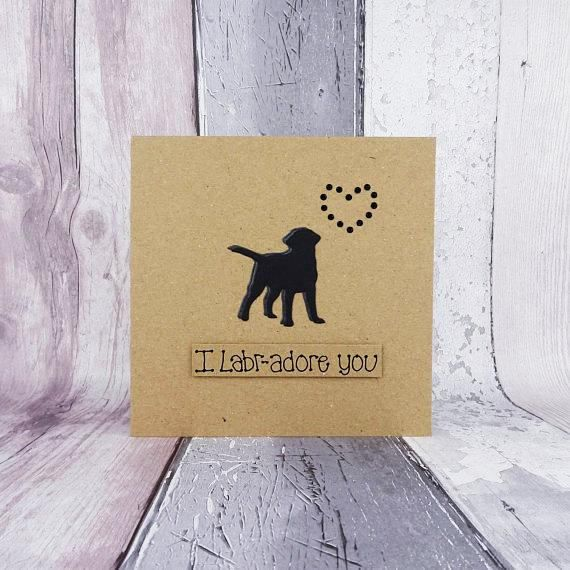 Unique handmade Black Labrador card - dogs silhouette and heart of red round gems. Anniversary or Birthday card.  The card has a the silhouette of a Black Labrador (Black Lab) standing happily with their tail in the air. The shadow of the dog is red card and there are red round gems in the shape of a heart just above the dog. The sentiment is added with 3D foam and reads: I Labr-adore you  PERSONALISING YOUR CARD: You can choose the colour of the matching shadow and gems used to make the…