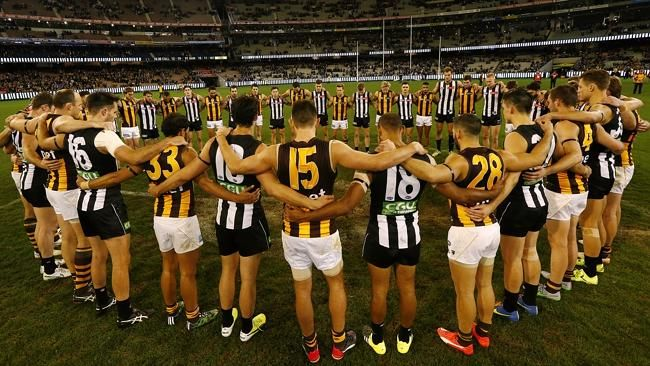 Collingwood and Hawthorn come together at the end of the game. Pies + Hawks = respect. R.I.P Phillip Walsh. Picture: Wayne Ludbey