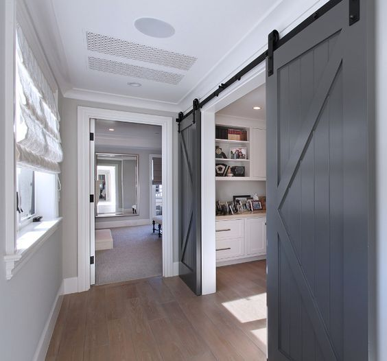 Barn doors conceal a home office The charcoal gray barn doors are painted in Benjamin Moore Kendal Charcoal – Semi Gloss finish.