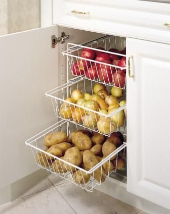 Wire vegetable drawers in standard base cabinet. Wellborn Cabinets.