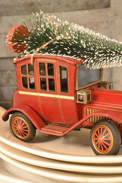 Christmas - I have a toy truck that we keep green bottle brush trees in all year until Christmas and then I put the snow covered ones.