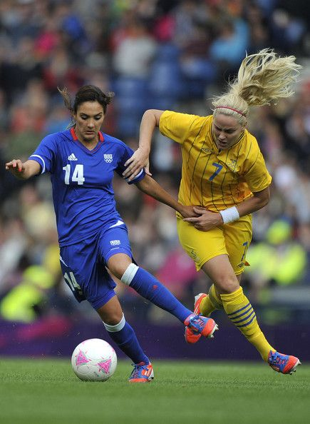 Louisa Necib of France and Lisa Dahlkvist of Sweden battle for the ball during the Women's Football Quarter Final match between Sweden and France, on Day 7 of the London 2012 Olympic Games at Hampden Park on August 3, 2012 in Glasgow, Scotland. (August 2, 2012 - Source: Francis Bompard/Getty Images Europe)