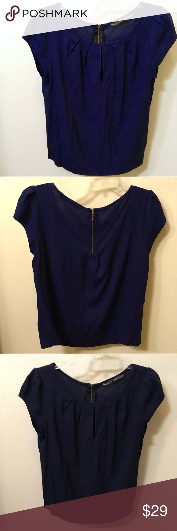 Zara Basic SS Navy Blue Blouse Zip-Up Back (M) Zara Basic Short Sleeve Navy Blue Blouse W/Zip Up Back. Beautiful Pleated Front w/Keyhole Design! Size (M). Very Lovely Blouse! Perfect Condition. [Worn/Washed Once for a couple hours - was not my size] Like New! Zara Tops Blouses