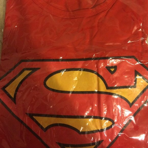 Women's Superman logo Tshirt🎀🛍 Red Superman logo Tshirt , says large but runs small. Tshirt still in the packaging. The logo has red in the yellow part as shown in the pic.  🤑great to bundle🤑 Tops