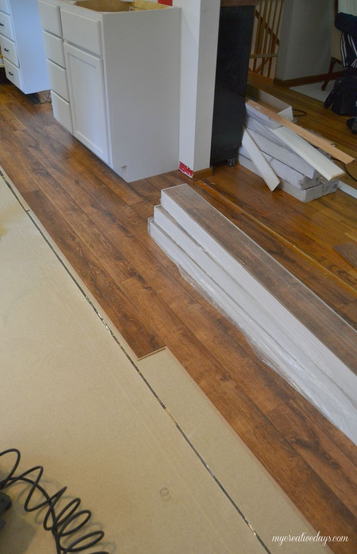 15 best images about flooring on pinterest for Laying laminate flooring