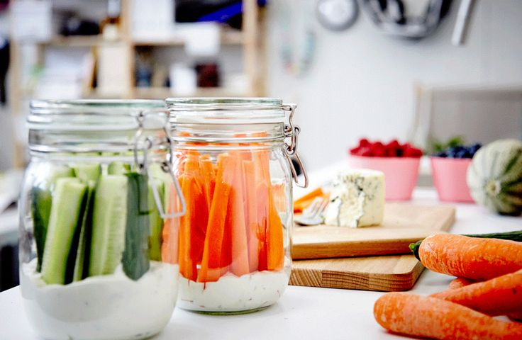 Picnic idea: jars containing ready to eat carrot and cucumber sticks and dip
