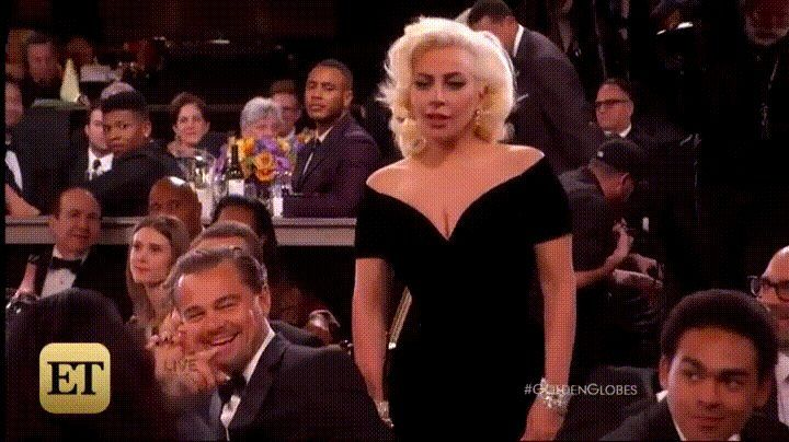 Lady Gaga accidentally nudges Leo and his reaction is priceless.