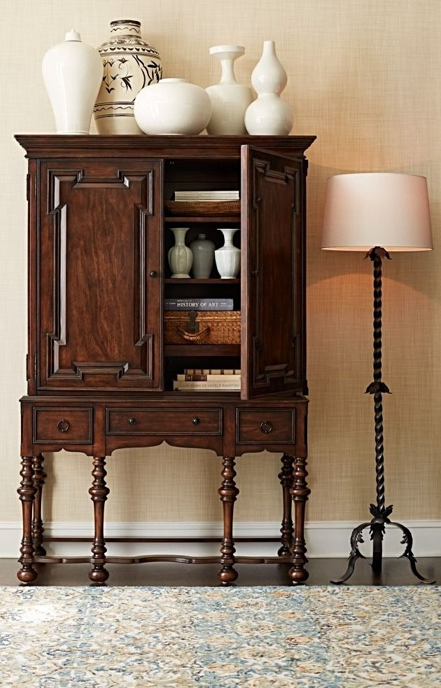 While the rich details of our exclusive Cabrillo Hutch belong to another age, its modest size and sophistication belong anywhere in your home. This stunning Mediterranean-inspired composition is made from solid mahogany, with turned legs, a delicately shaped apron and carved paneling on the doors and drawer fronts.