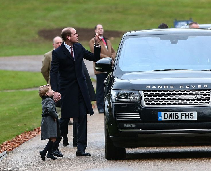 Prince William pointed something out as his inquisitive three-year-old son looked up befor...