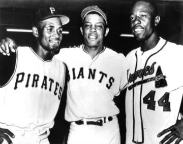 Roberto Clemente, Willie Mays and Hank Aaron.   Roberto was the only player in the history of baseball where the 5 year rule to the Hall of Fame was suspended when he died flying supplies to his home country!