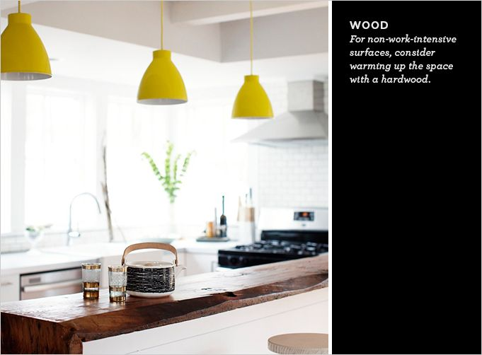 Kitchen Counters | Like the wood for an extra ledge on the island