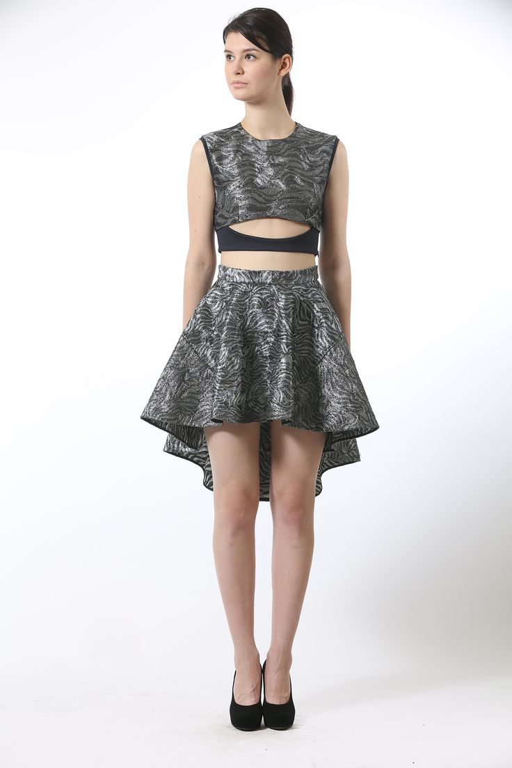 TOP: Lycra jersey crop top featuring silver metallic embroidery on the front panel with a cut-out detail and an off center conceal zip bone detail. BOTTOM: Silver metallic embroidered silk organza skater skirt featuring an asymmetrical hemline and a conceal zip bone detail.