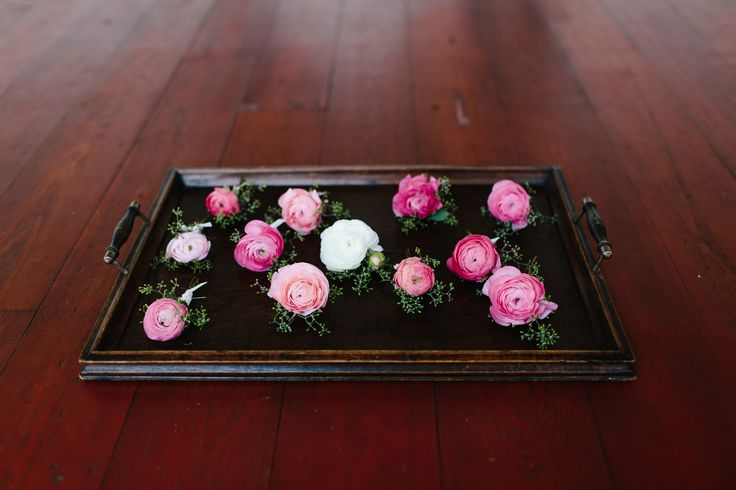 ranunculus boutonnieres arrive- white for the groom, and pink for the groomsmen.