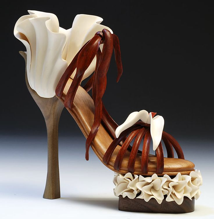Shoes carved in wood, high heel art shoes wood carvings.   The Art Work Of Denise Nielsen and George Worthington