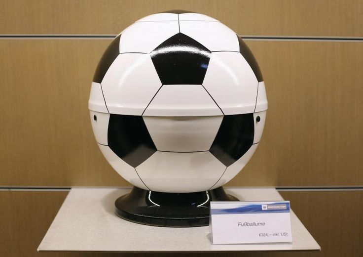 An urn shaped like a soccer ball is pictured in the workshop of Vienna's municipal funeral services (Bestattung Wien) in Vienna, Austria April 10, 2014. REUTERS/Leonhard Foeger