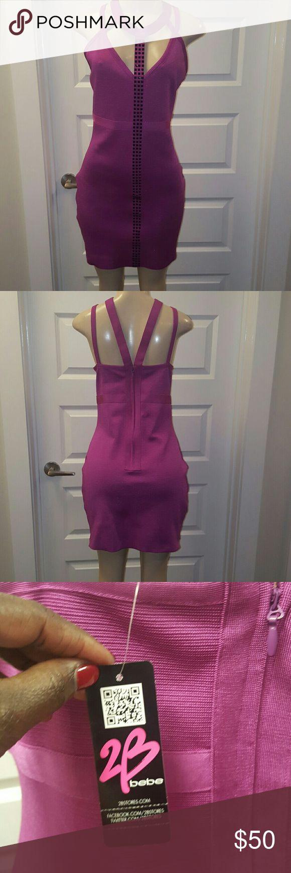Brand NEW Pink purple bandage studded dress Brand new pink purple bandage dress with black studs/rhinestones down the middle bebe Dresses