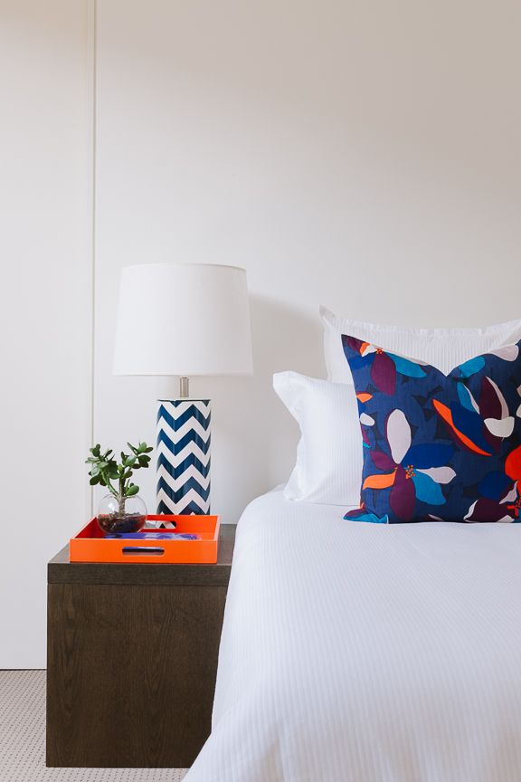 Colour Popping. Orange and Navy The Real Estate Stylist.  Citta Design Cushions available at  www.cittadesign.com