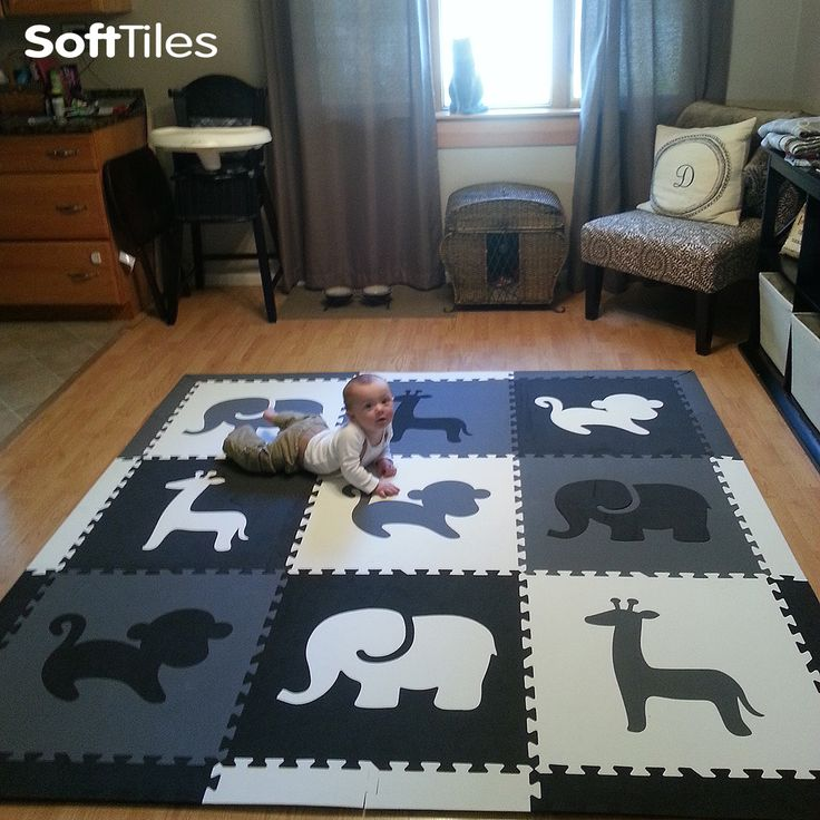 Turn any living room into a fun designer play area with SoftTiles Safari Animals Play Mat in Black, Gray, and White. Perfect for cushioning on hardwood and tile floors. #playroom