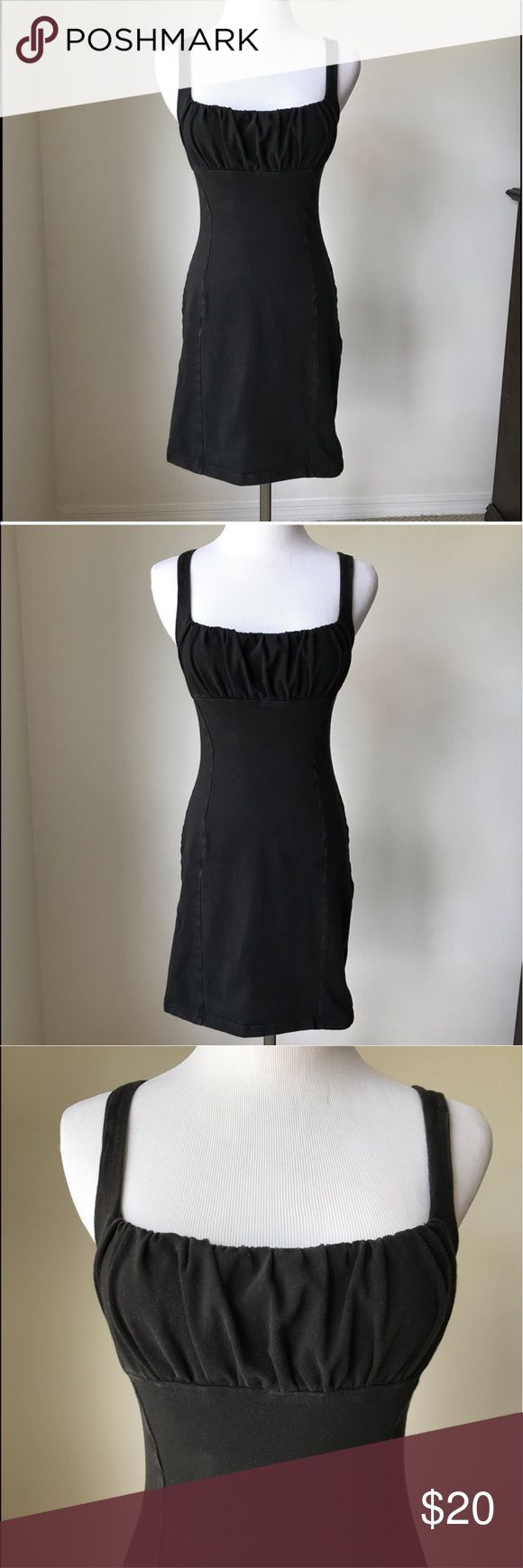 Victoria's Secret Black Beach Cover Up VS beach cover up with built in bra. Form fitting with lots of stretch and ruched area over bust. I've worn it a bit both to the beach and as a going out dress very comfortable. Has no rips, tears or stains. Does have a little fading due to sun. Has been cleaned and ready for wear.  Comes from a pet free and smoke few home. Victoria's Secret Swim Coverups