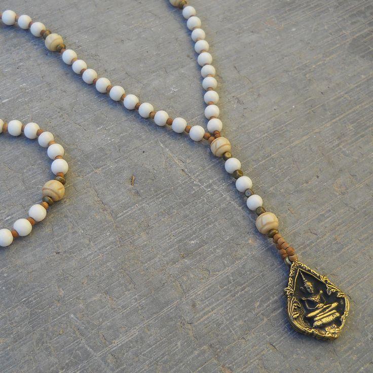 enlightment, white wood and sandalwood rosary style necklace with Buddha pendant
