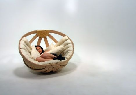 Basket Rocking Chair. I want to curl up in it with a good book and fall asleep.