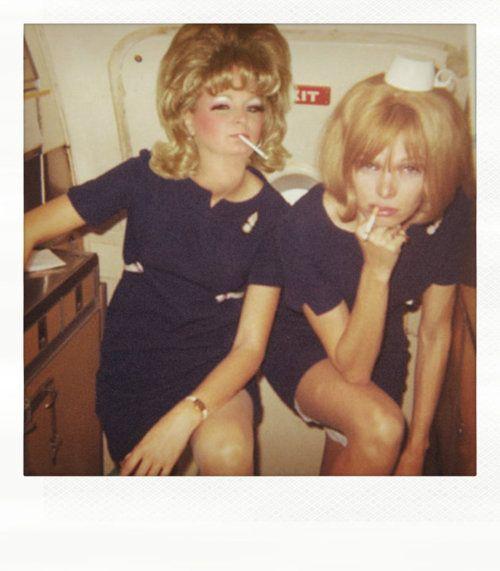 60s stewardesses having a smoke during a flight.