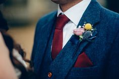 Image result for blue suit burgundy bow tie