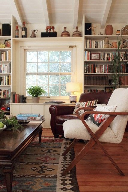 Love the feel in this image.  The arm chair shown has a great modern look, and I like the wood arms and frame style.   I would also like to find a place for a book shelf somewhere in the lobby (perhaps the bar or restaurant or hallways to meeting rooms?) to have lots of interesting artifacts, and have it well lit.