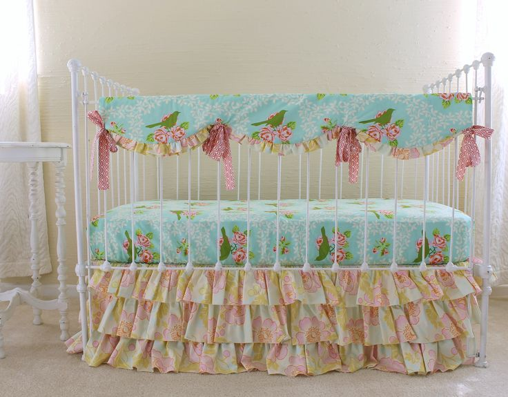 Wonderful Coral And Turquoise Bedding For Bedroom Decoration Ideas: Skirted Crib With Coral And Turquoise Bedding And Cream Wall For Pretty Nursery Design Ideas