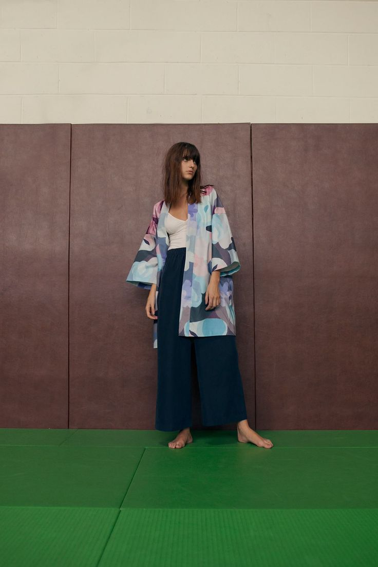"""Unisex gabardine denim Kimono with the """"Blue Camoflower"""" pattern printed on  all sides, oversize fit.  - All over print. - Denim Gabardine (98% Cotton). - Oversize fit. - Silk printed lining. - Made in Paris.  Photo © Fiona Torre"""