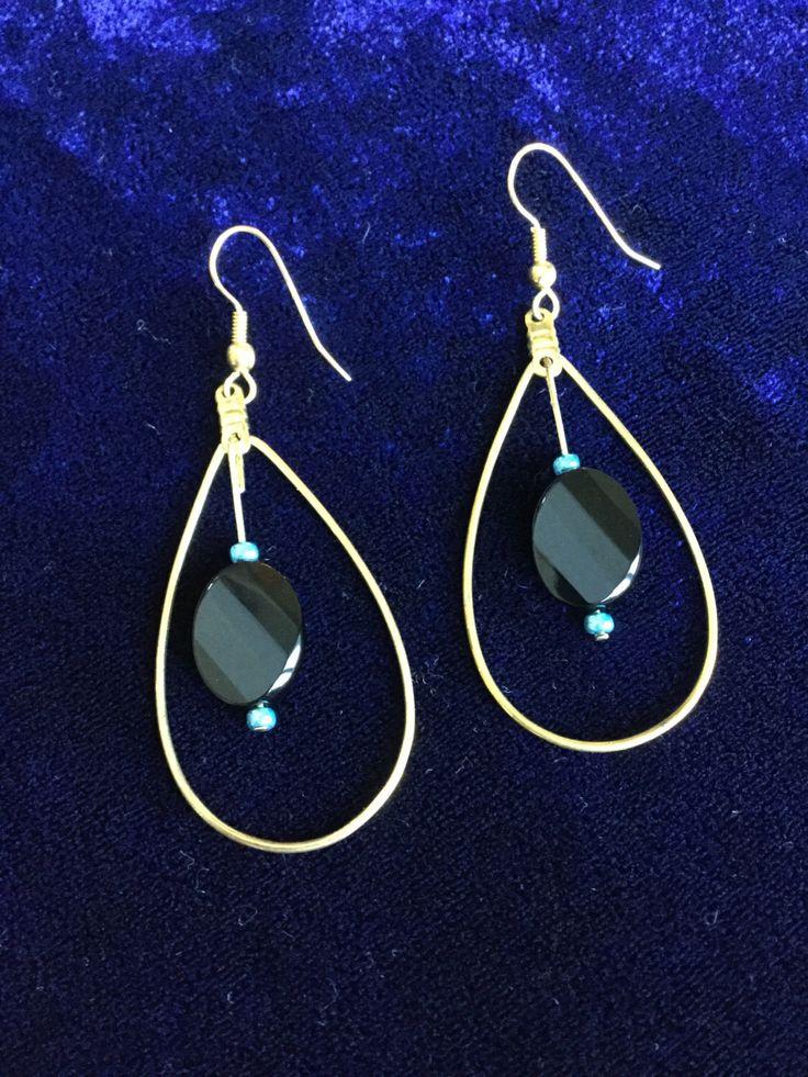 Dangling tear drop shaped earrings by M1CreativeCreations on Etsy https://www.etsy.com/ca/listing/491147254/dangling-tear-drop-shaped-earrings