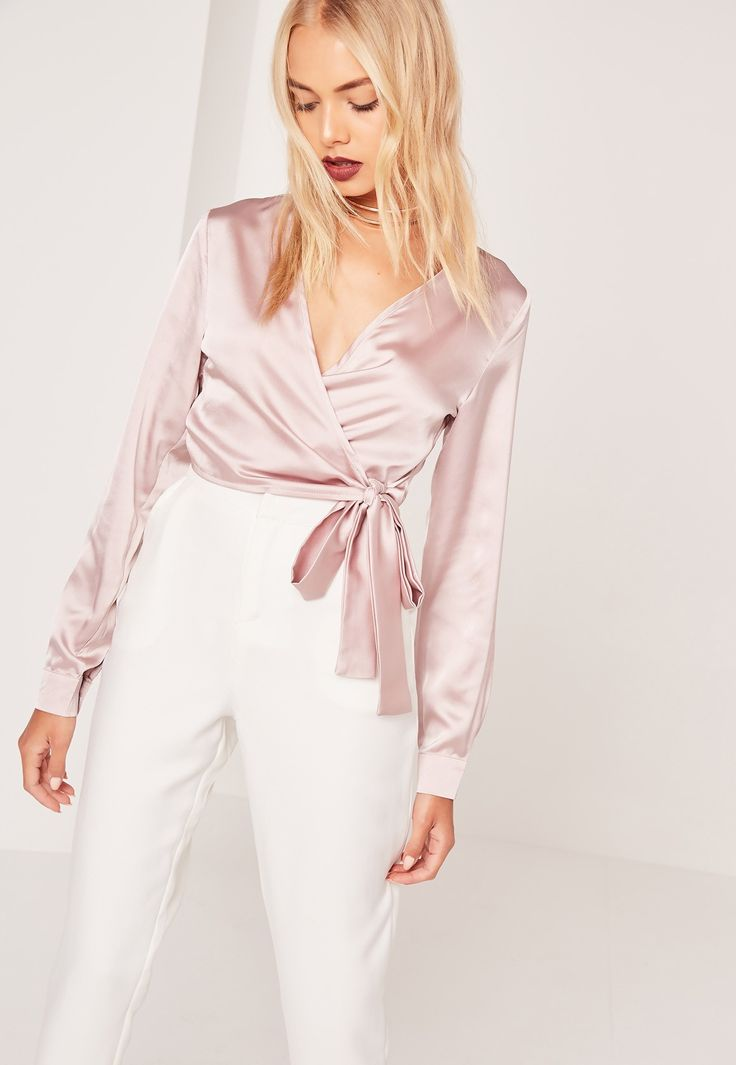 Satin elevates any outfit so get wrapped up in this 'lil crop. In a playful mauve hue, luxe satin feel, long sleeves and a chic wrap front with tie side, style with tailored trousers and barely there heels for a sweet take on off duty satin...