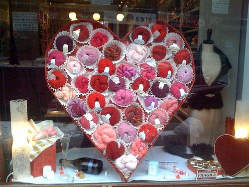 UNKNOWN | Make everyday items look festive in this this heart shaped candy box look.  Try using large/commercial size coffee filters for the candy papers & gift wrapped cardboard for the box.  You can find supplies for this project at www.bagsandbowsonline.com #ValentinesDay #StoreDisplay #VisualMerchandising