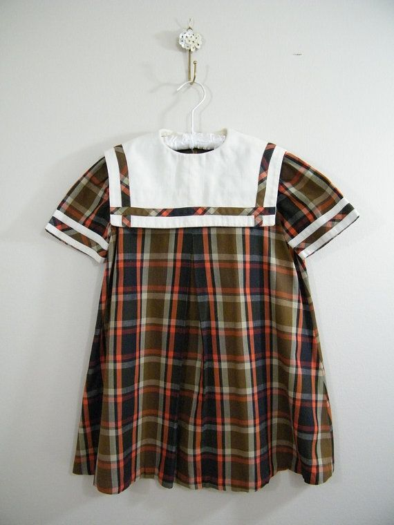 Vintage 1960's little girl's school dress.  We weren't allowed to wear slacks til about 1970.  Even then they had to be matching pants and a hip length tunic top.