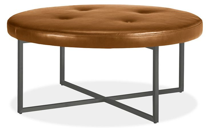 Our round, leather Sidney ottoman offers a classic look with a modern twist. Its intersecting steel base adds modern flair to the tufted cushion top. Use this ottoman as a place to put up your feet, set your book or as extra seating anywhere in your home. The flexibility and function that Sidney offers is matched by its comfort and style.