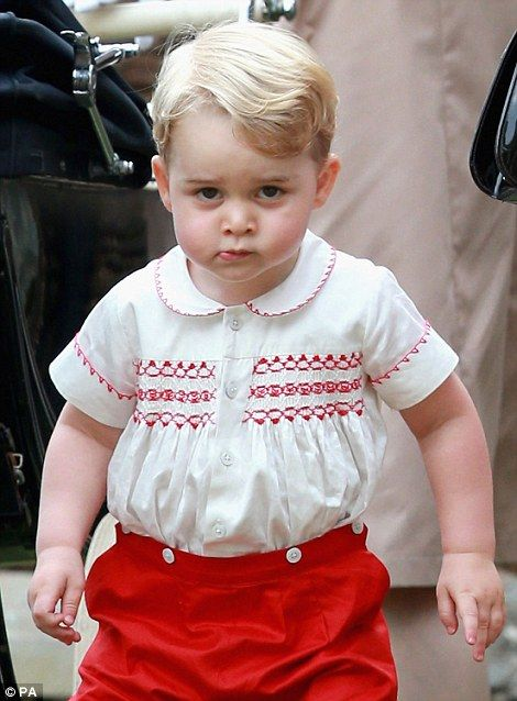 Prince George seemed at times overwhelmed by the crowds that came out to greet the family making their way to the church for his sister's christening
