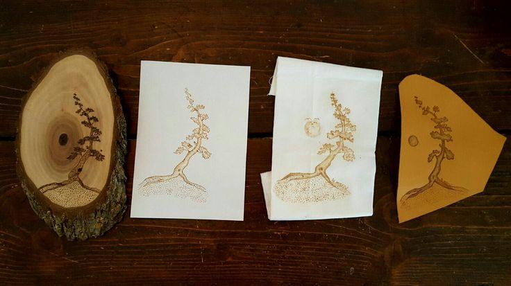 Stesso albero, materiali diversi..Pirografia su acacia, carta, lino e cuoio