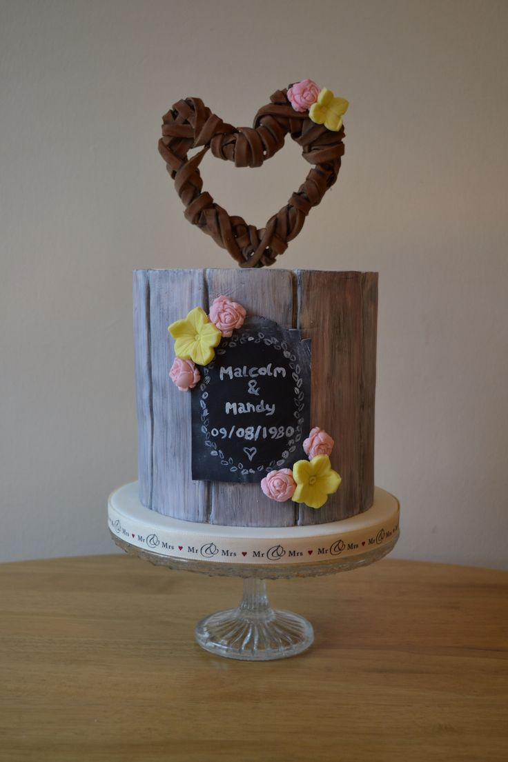 First of my display cakes ready for Septembers wedding fair at Ramside hall hotel.  A tribute to my parents who are celebrating their 35th wedding anniversary today  This cake looks great on its own, or would fit perfectly as a tier in a larger cake. Antique painted panel look, with chalkboard and wicker effect heart topper. See more at www.facebook.com/emmazingcakes