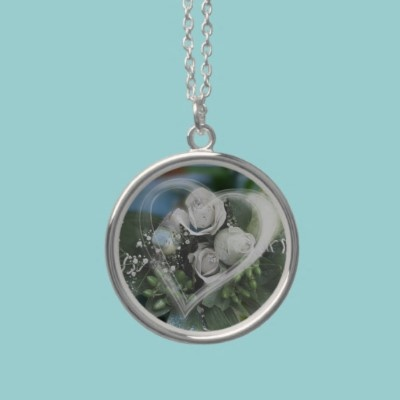 Love necklace  A lovely necklace pendant with a beautiful bunch of white roses a blue bird and a soft white heart. A nice bridal or wedding anniversary gift.  $32.90